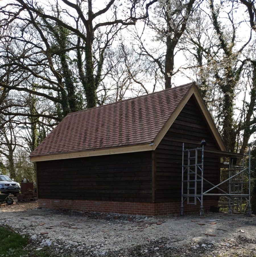 Large garage with wooden cladding